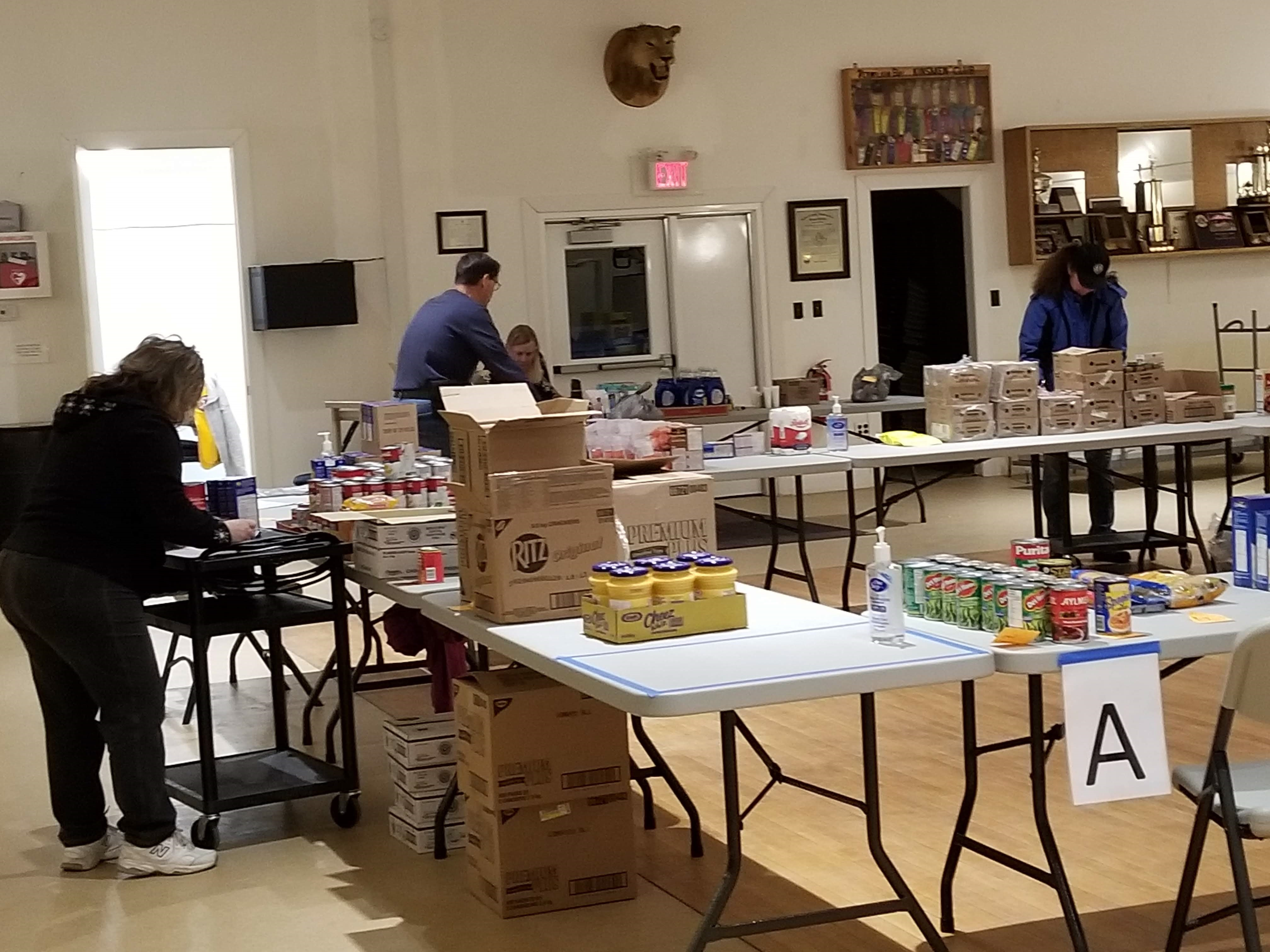 Lions sort items to be distributed to local food pantries