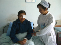Nurse treating visually impaired patient